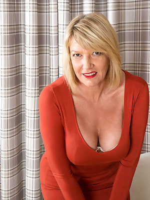 It's English granny Amy Goodhead's first time getting naked on camera and this busty cougar finds it titillating. Her bra and sheer panties are soon pushed aside, leaving her huge knockers and landing strip fuck hole ready for the touch of her magic finge