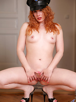 Officer Monita is ready to bring you to your knees! This blazing Czech redhead may dress up nice, but she undresses even better with her all natural small tits and her cock craving landing strip pussy that is desperate to be filled up and fucked hard unti