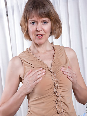 Foxy cougar Jamie Foster is loving her ultra tender boobs. She can't seem to keep her clothes on, instead choosing to open her bra to play with her tits and then slip off her underwear so that her slippery bare fuck hole is on display for her to enjoy her