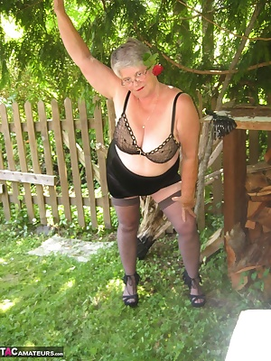 Loving the great outdoors, wearing a HOT leopard  print outfit. stockings, and check out those HOT come fuck me hi heels