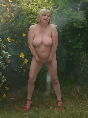 I had arranged to meet the Dirty Doctor My Photographer out the Back of The Villa for a Shoot, Naked and just in my Red