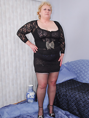 How do you like my black lace corset slip... I like how you can see a hint of the blue lacy panties I wear underneath wi