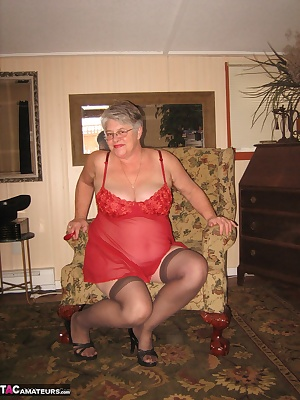 Red HOT Mama, loves to show off in red thong panties ,stockings and heels. Look at that beautiful round ass.