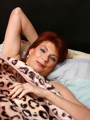Lying in my bed I start to play with my clit and pull my pussy wide open. Then moving to a chair in my front room dress