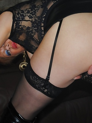 Mistress Dimonty in her short leather skirt, thigh length boots, black see through top and black cap flashes her tit and