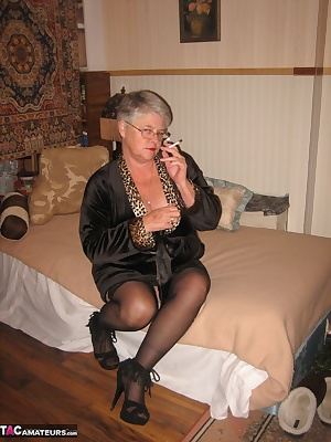 Smoking Hot Girdlegoddess spread out on the bed, wearing my leopard print kimono, black stockings and  sexy hi heels.