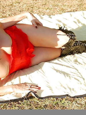 In my local park dressed in my red basque and thigh length boots with my dominatrix mask I strip off and find I need a p