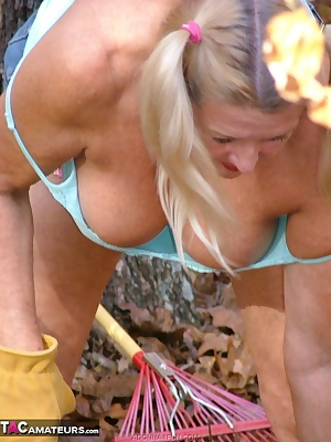 Working in the yard in Daisy Dukes, tank top and knee boots - until it gets too hot and the clothes come off.