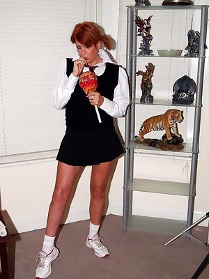 Dressed as a schoolgirl sucking my lolly pop and flashing my white panties.
