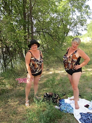Sexy in our swimsuits, Girdlegoddess and Mistress Sue enjoy a refreshing dip in the river. Oh yes looks like those naugh