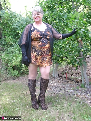 Mature Girdlegoddess in the orchard wearing her sexy leopard print outfit. Look at my hairy pussy while I'm wearing leop