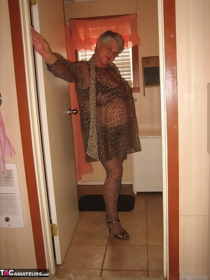 Big momma, Girdlegoddess, is sexy hot in leopard print sheer cover up. Just getting ready for a nice shower. Look at how