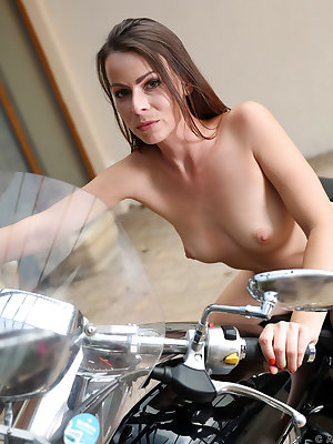 There's something hot about a woman in leather as Caroline Ardolino will help you see. After peeling off her leather clothes, this cock craving housewife seats herself on her motorcycle and prepares to rev her own motor as she strikes a variety of sexy po