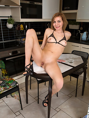 Judith Angel is proud of her bouncy little tits, and she enjoys dressing to accentuate her perky knockers. Showing off her assets is a huge turnon for this Russian mom, who just can't keep her fingers from straying to her greedy bare twat and diving in fo