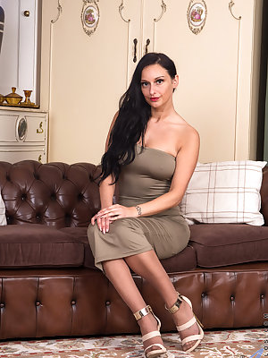 European hottie Cassie Clarke is aging gracefully as she gets older. She still has one hell of a figure that she often shows off with tight gowns. As she starts slipping out of her clothes, her hands roam all over her ass and breasts before settling betwe