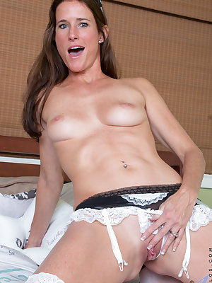 Naughty maid Sofie Marie wants you to make her nice and dirty. She taunts you by flaunting her nice ass beneath her tiny miniskirt and playing with her hard nips through her peekaboo bra. Then she whips out a glass toy and works it deep into her cum cravi