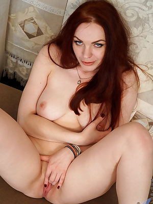 Cock craving redhead Alice Wonderland is a Russian housewife with big boobs you'll want to squeeze and a tight body you'll want to fuck. This all natural babe is always wet and ready to go as you'll see once she peels her thong off to reveal her cream fil