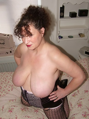 If you like busty ladies I hope you enjoy this set of pics. As you know I pick a member each month to star in a film wit