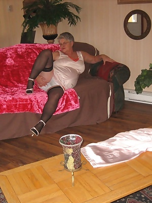 Girdlegoddes, relaxing in a sexy nitie on the sofa, wouldnt you know it, she just has to lift her nitie and play with he