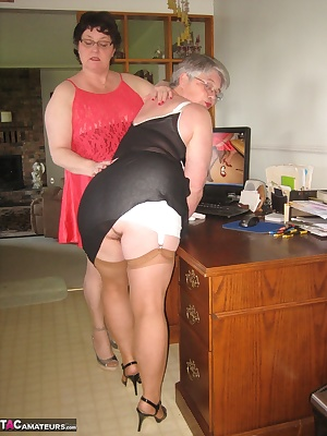 Sexy Girdlegoddess, and Mistress sue, team up for a little strap on play. While Mistress is out of the room, Girdlegodde
