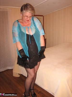 Relaxing in my room, in my sexy black teddy and girdle. Just the right time to strech out and play with my dildo. I want
