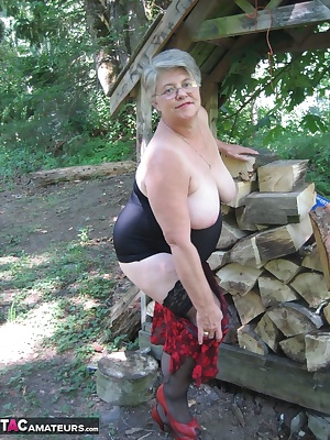 Sexy momma, out at the wood pile, oh ya , in need of a good fucking. Bend me over baby, and give it to momma good.