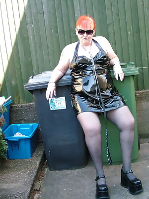 Black PVC and a HOT day makes for some cheeky pics in the garden.