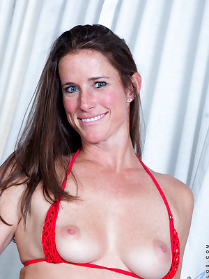 With such a tight body at 37, it's no wonder that Sofie Marie is a huge showoff. She's a hot blooded American mom with a great set of small tits, a slim ass that is still a perfect handful, and a bare smooth pussy that begs to be fucked hard by a big dick