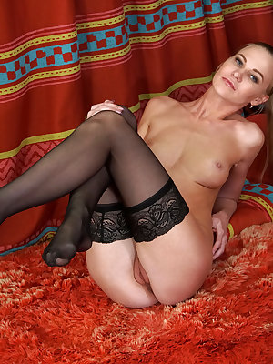 Get ready for lusty Tatiana, a tall slim Russian housewife who's happy to peel off her bra and thong for your pleasure! She's slow to take her clothes off, but once she's down to just her thigh high stockings she slips her hand between her slim thighs to