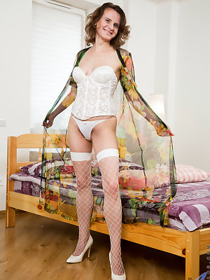 Russian mom Princess Mustang is wild and crazy in the best possible way, and will do anything to bring off her hairy pussy. Decked out in lingerie, the horny housewife takes her time stripping before reaching for a dildo to lick and pound deep into her cl