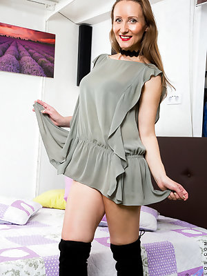 Solena is 38 and always horny. The hot Russian mom peels off her dress so we can see her big floppy tits and then slides her hand down her belly to rest between her thighs. Her landing strip pussy is wet and waiting for her magic fingers and vibrator to m