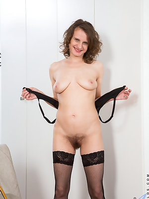 Dressing up in costumes is a sexy way for 41 year old mom Princess Mustang to explore her sexuality. Peeling off her sheer thong, bra, and thigh high stockings, she gradually works her way out of her clothes until she can use her magic fingers to work her