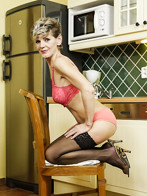 Mature granny naked and horny exposing wrinkly titties in the kitchen