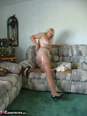 Showing off in garter belt and stockings - lots and lots of leg showing here - as well as some great ass shots.