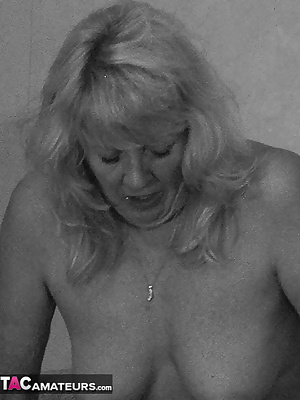 My first time on a sybian - what a wild ride.  Pictures in black and white emphasize my black stockings as I mount the v