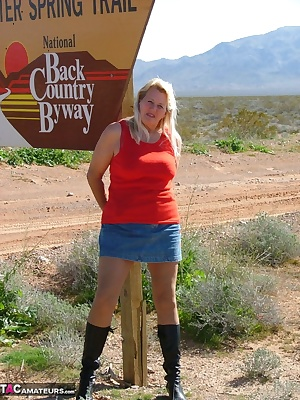 Like tits, pantyhose and boots  Come watch me as I get a little sun in the Nevada desert - and on a public road no less