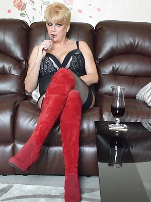 Well here I am wearing my suede boots,corset and stockings waiting for the party to start. So I have a quick drag on my