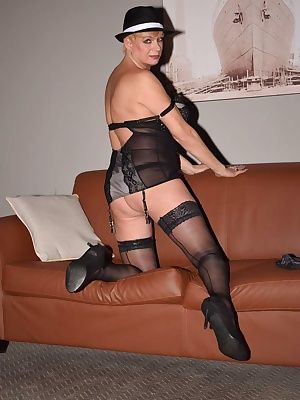 Picture of Gangster Dimonty stripping off  her suspender and stockings and Basque to reveal her sexy naked body.