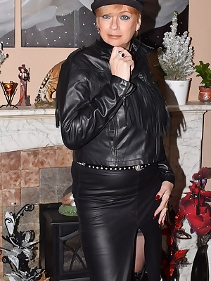 Mistress Dimonty wears a leather skirt and jacket with black suede boots. Then strips down to her strappy underwear reve