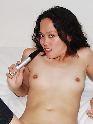 Kimberley, Filipino porn model nude and masturbating with small vibrator.