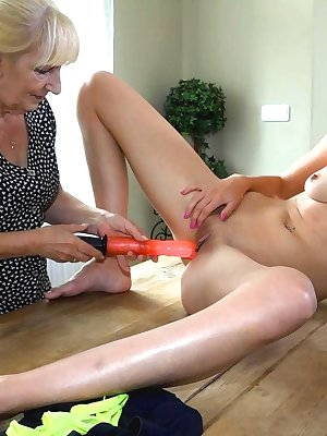 Sexy young lesbian woman is masturbating pussy with granny