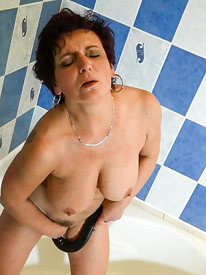 Sexy horny mature play with horny dildo in the shower