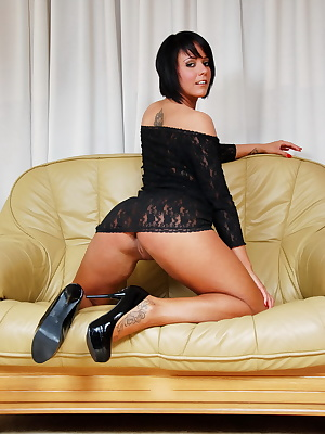Scarlett Hope dressed in a much to short see-through black dress and high heel shoes. Scarlett is showing her beautiful