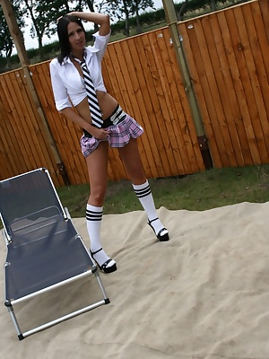 Tracey is dressed in her hot school uniform and is relaxing in the garden. Handyman Freddie comes along to fix her fence