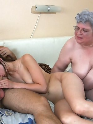 Old and young lesbians making use of big double dildo