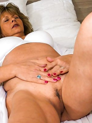 Cute blonde mature gets teased by naughty younger girl