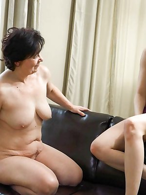Kinky mature woman strapon fucked by her young female friend