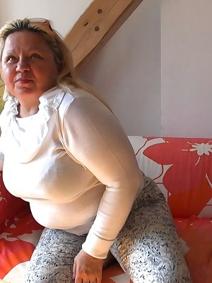 Gorgeous blonde mature Sonja teasing with her sexy chubby body