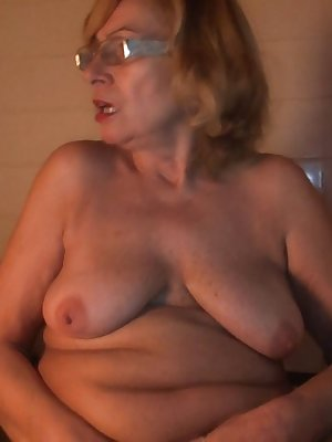 Gorgeous blonde mature getting ready to take care of cock