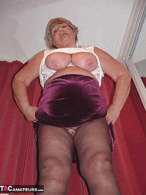 Horny Grandma loves showing off her crotchless tights and gets real dirty with her favourite toys.  Cum and join her